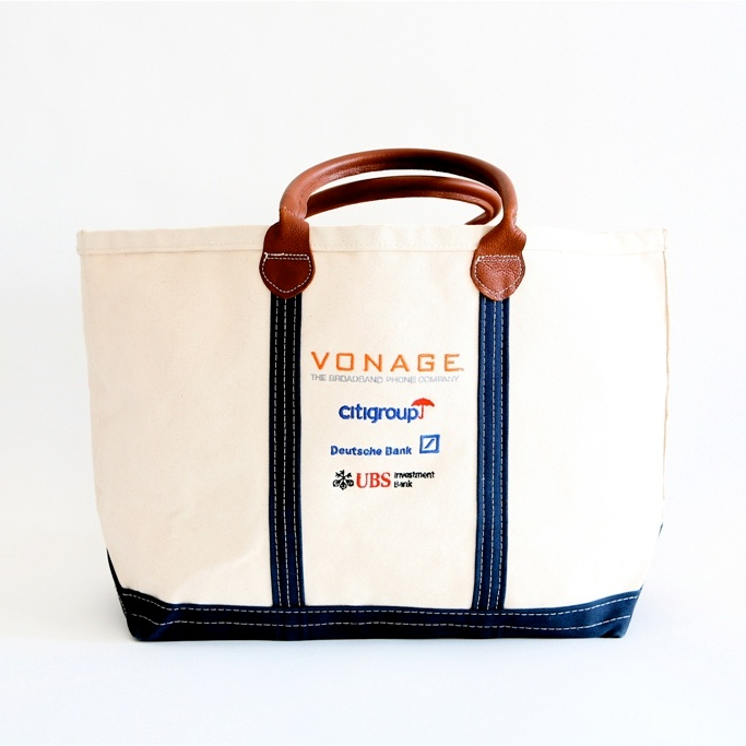 Style #1010: BankerBag tote with leather handles, stitched ribbon details and logos as full color transfers.